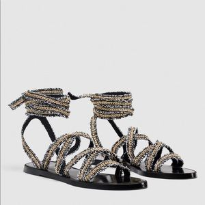 Sandals with metallic chain detail straps